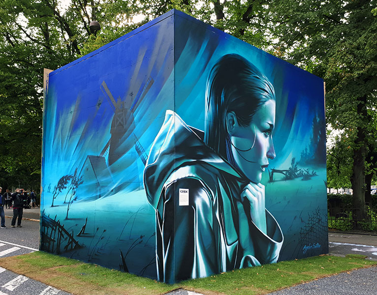Girl walking in the rainy weather, mural at Aarhus Fest Uge, Graffiti Festival 2017